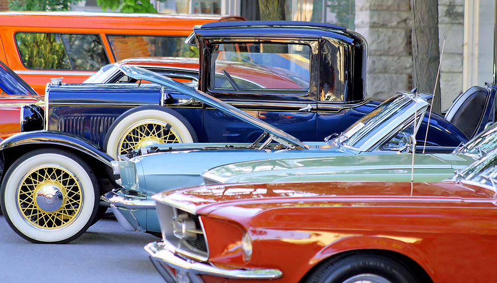 Classic cars parked along street