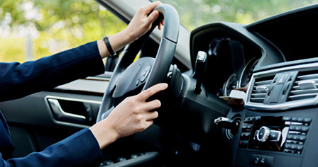 Driver with both hands safely on the steering wheel