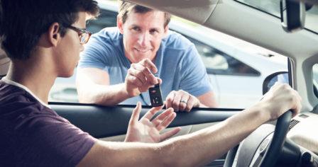 Teen driver receiving keys to the car