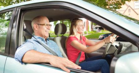 Parent coaching teen how to drive
