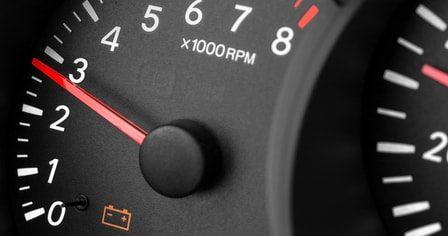 Car gauge cluster with battery warning light lit