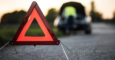 Warning sign on roadside while car gets serviced