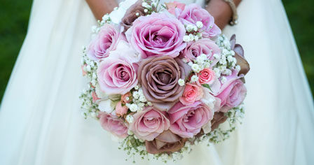 bride holding a pink wedding bouquet