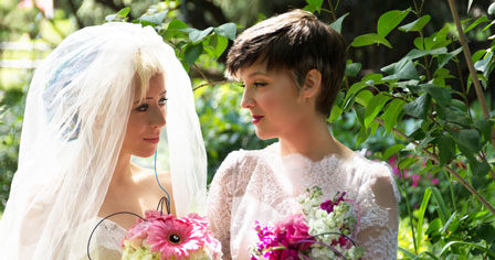 Two brides gazing at one another lovingly