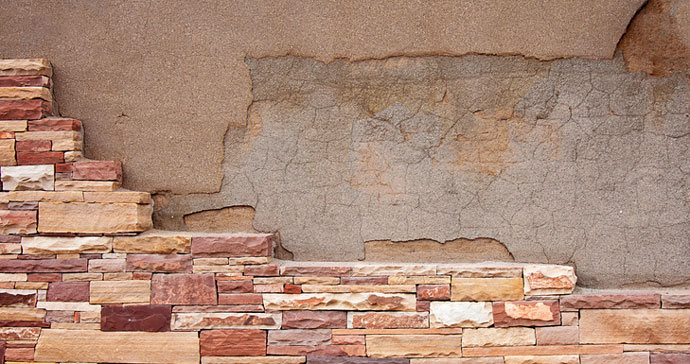 stone veneer bricks covering up old wall
