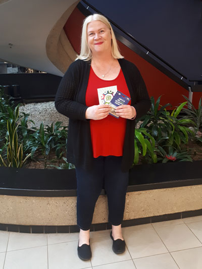 Susan Spaapen holding her Esso gift card Early Bird Prize
